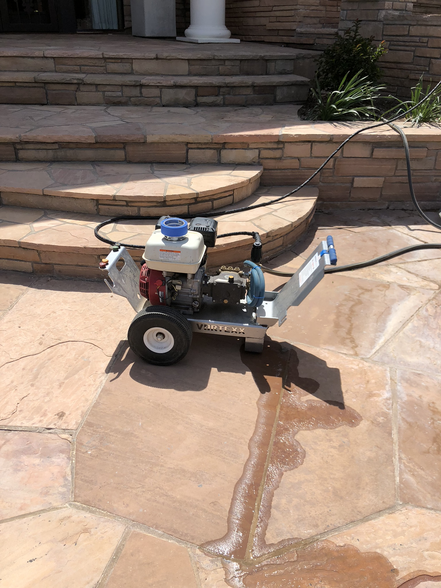 We utilized our pressure sprayer to prepare our flagstone decks prior to installing the Stone Armor product. Pressure washing your deck is a very important step in the installation process. It removes small dust, debris and miscellaneous particles from your deck. This provides a much better bond between the stone and the Stone Armor once applied.