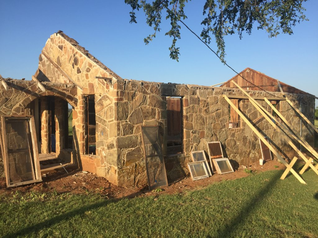 In order to prep this home for our renovation, we needed to remove the aged roof. It was both unsafe for our crew and unable to protect the inside of the home from the outside elements. Therefore, we are constructing a new roof for this beautiful home.